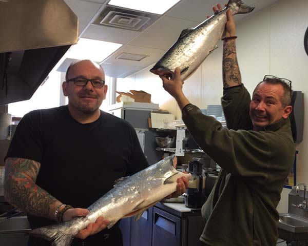 happy customers holding up their nerka salmon